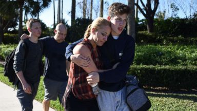 'PHOTO: Students react following a shooting1_b@b_1Marjory Stoneman Douglas High School in Parkland, Fla., Feb. 14, 2018.' from the web at 'https://s.abcnews.com/images/US/parkland-shooting2-gty-ml-180215_16x9t_384.jpg'