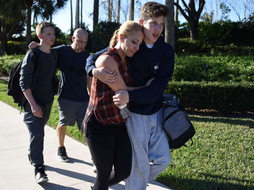 PHOTO: Students react following a shooting at Marjory Stoneman Douglas High School in Parkland, Fla., Feb. 14, 2018.
