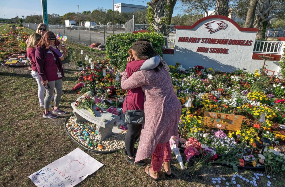 PHOTO: People visit a makeshift memorial in front of the Marjory Stoneman Douglas High School in, Parkland, Fla., Feb. 14 2019, on the one-year anniversary of the shooting.