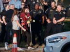PHOTO: Marjory Stoneman Douglas High School staff, teachers and students return to school greeted by police and well wishers in Parkland, Fla., Feb. 28, 2018.