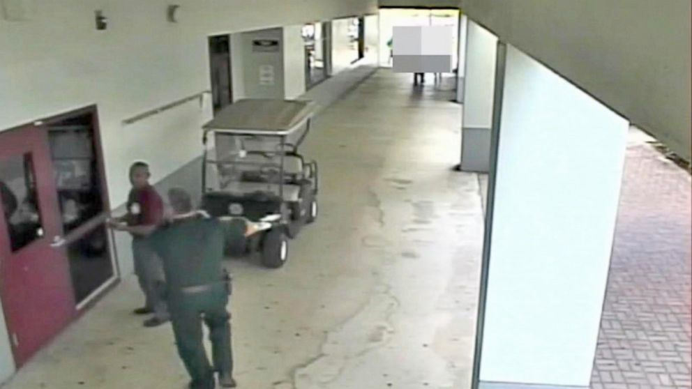 Surveillance video shows resource officer's response during Florida school shooting