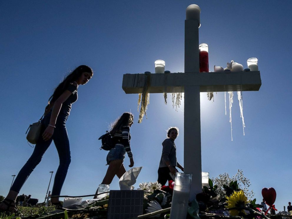 PHOTO: People visit the temporary memorial at the amphitheater at Pine Trails Park, Parkland, Florida, Feb. 16, 2018. The memorial honors victims of a mass shooting that took place at Marjory Stoneman Douglas High School that left 17 dead.
