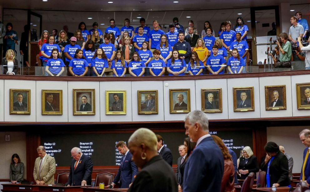 PHOTO: Students and their chaperones from Marjory Stoneman Douglas High School, wearing blue t-shirts, stand in the gallery above the Florida Senate as it held a moment of silence in honor of the victims of the mass shooting, February 21, 2018.