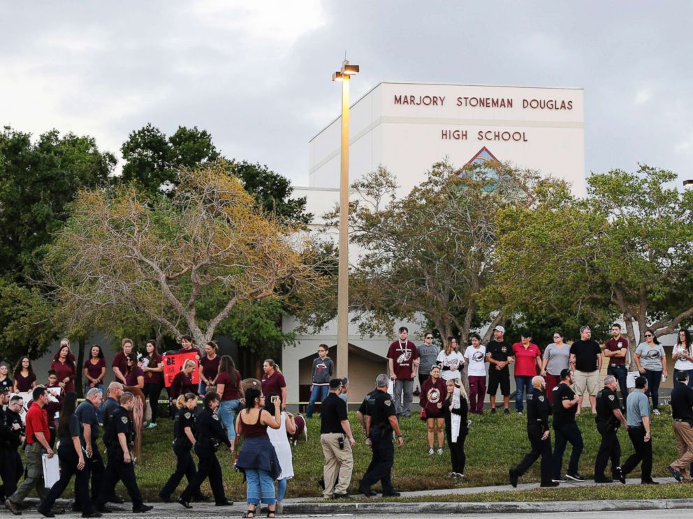PHOTO: Police walk outside Marjory Stoneman Douglas High School in Parkland, Fla., Feb. 28, 2018.