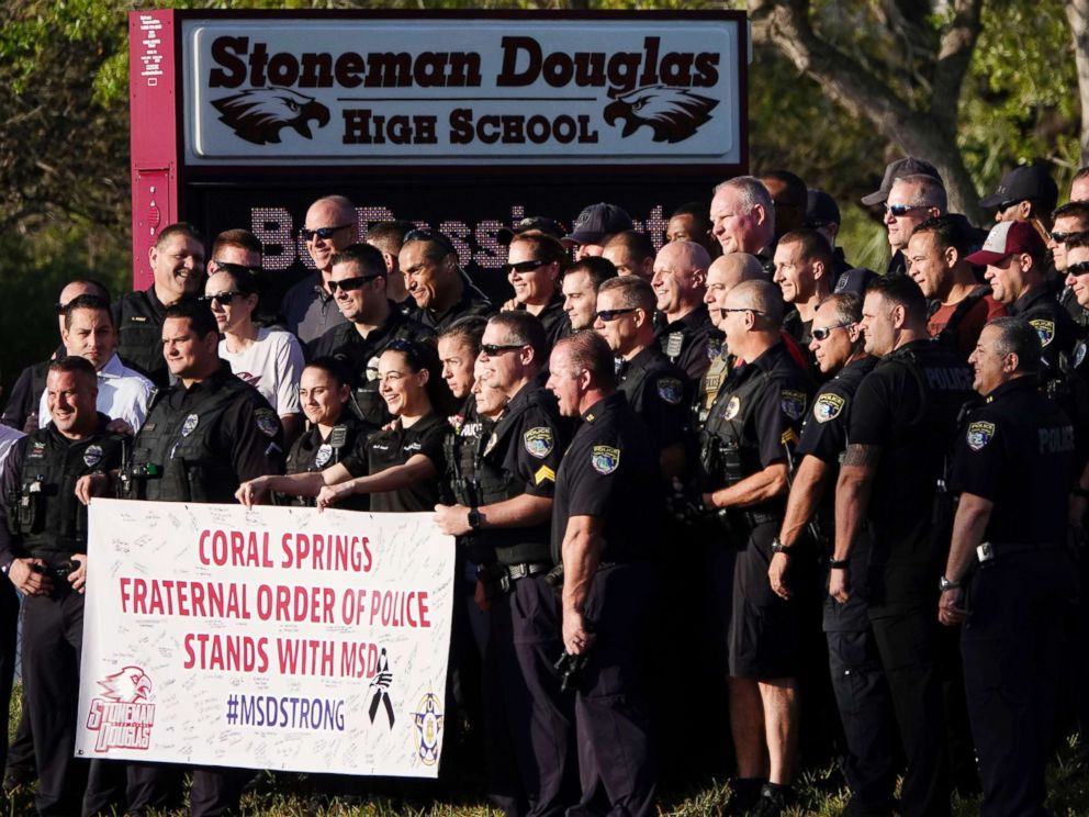 PHOTO: Police pose for a photo after they escorted returning students to Marjory Stoneman Douglas High School in Parkland, Fla., Feb. 28, 2018.