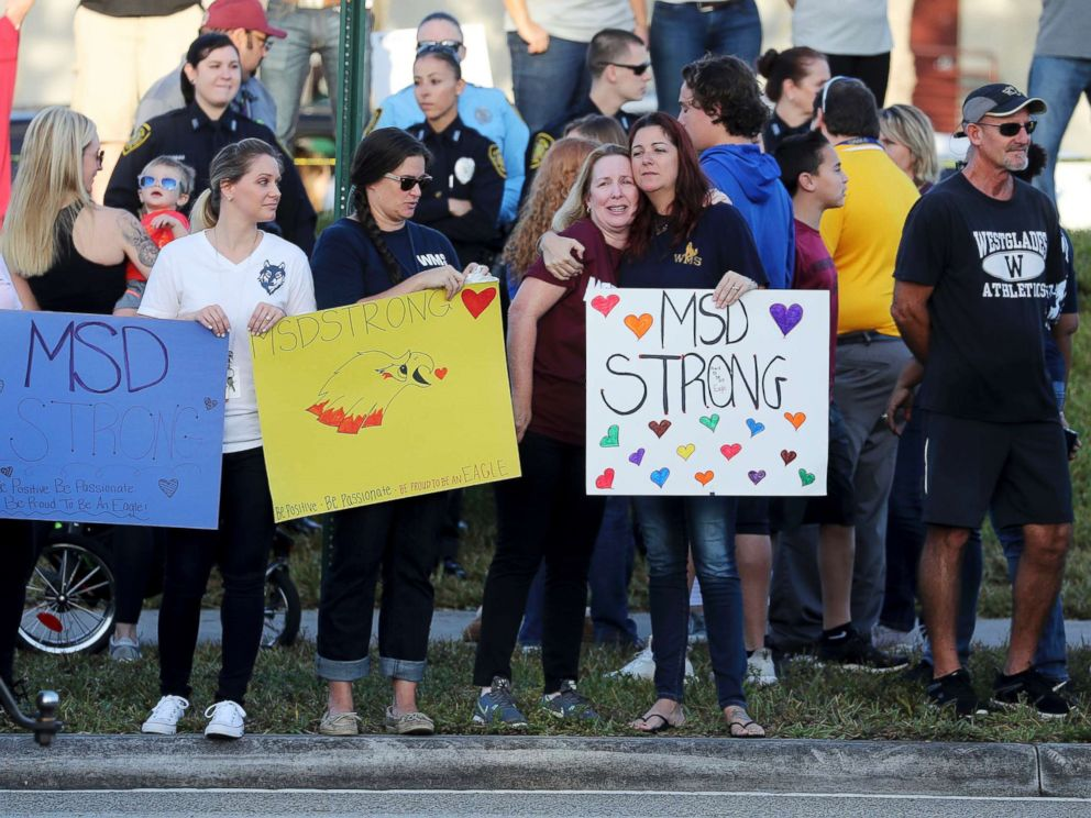 PHOTO: Supporters hold signs as students head back to classes at Marjory Stoneman Douglas High School in Parkland, Fla., Feb. 28, 2018.
