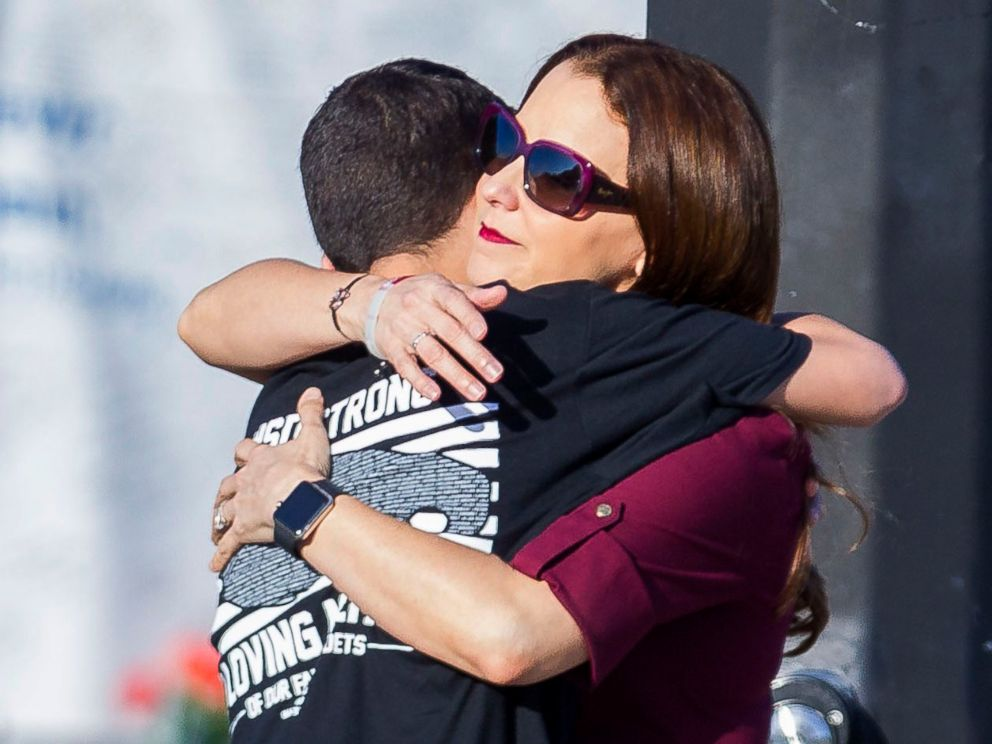 PHOTO: Nelson Laboy hugs his mother, Camille Aponte, after making their way to the entrance of Marjory Stoneman Douglas High School, Feb. 28, 2018, in Parkland, Fla.