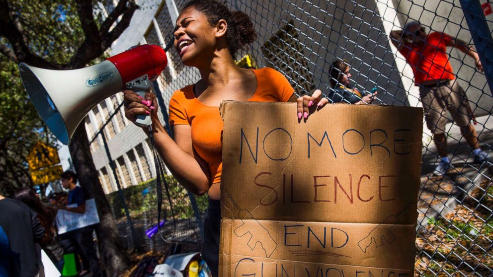 South Broward High School sophomore Genesis Campbell leads her classmates in protest in front of their school, Feb. 16, 2018, in response to a shooting at Marjory Stoneman Douglas High School in Parkland, Fla.