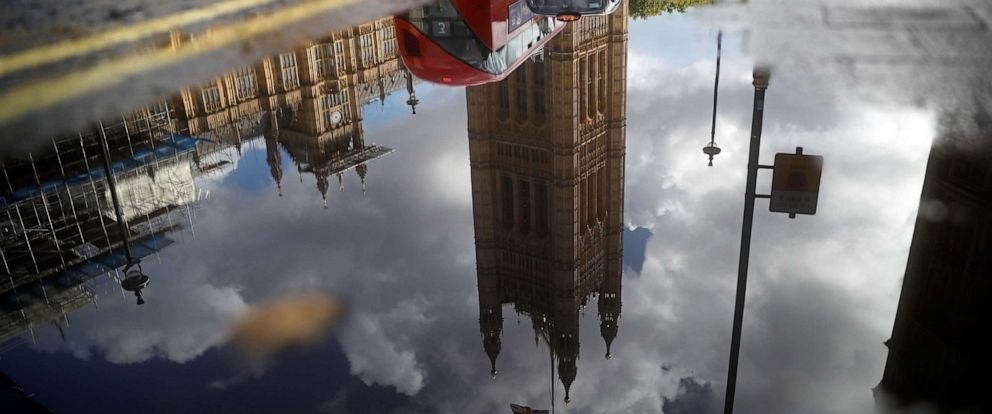 PHOTO: The Houses of Parliament are reflected in a puddle of rainwater in central London on Sept. 24, 2019, after the judgement of the court on the legality of Boris Johnsons advice to the Queen to suspend parliament.