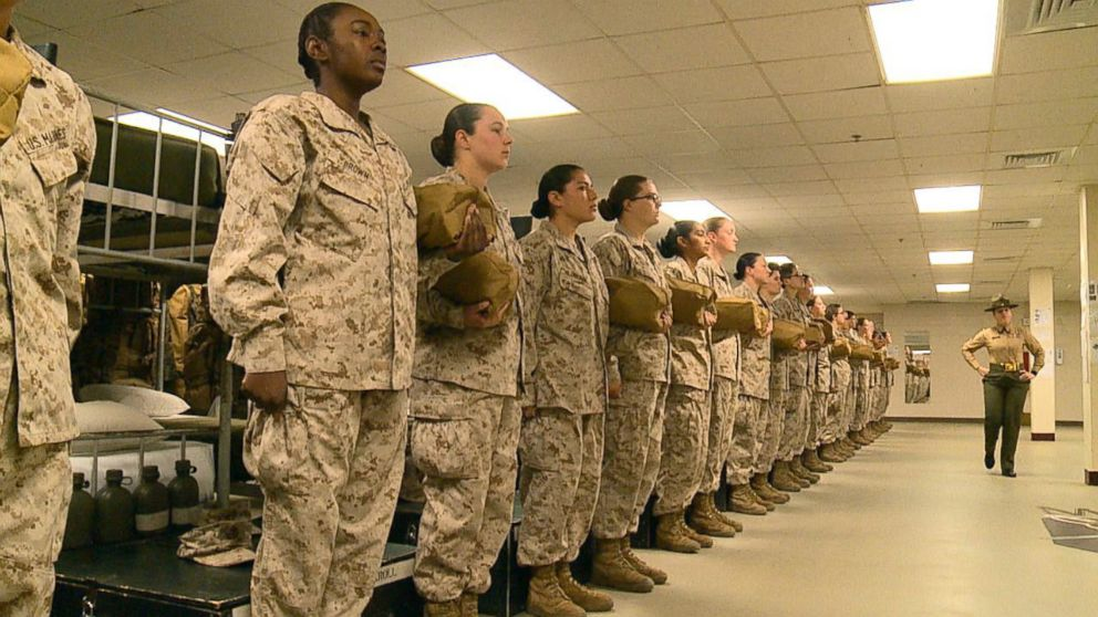 Female recruits stand at attention in a barracks at Marine Corps Recruit Depot Parris Island in South Carolina, Feb. 2, 2018.