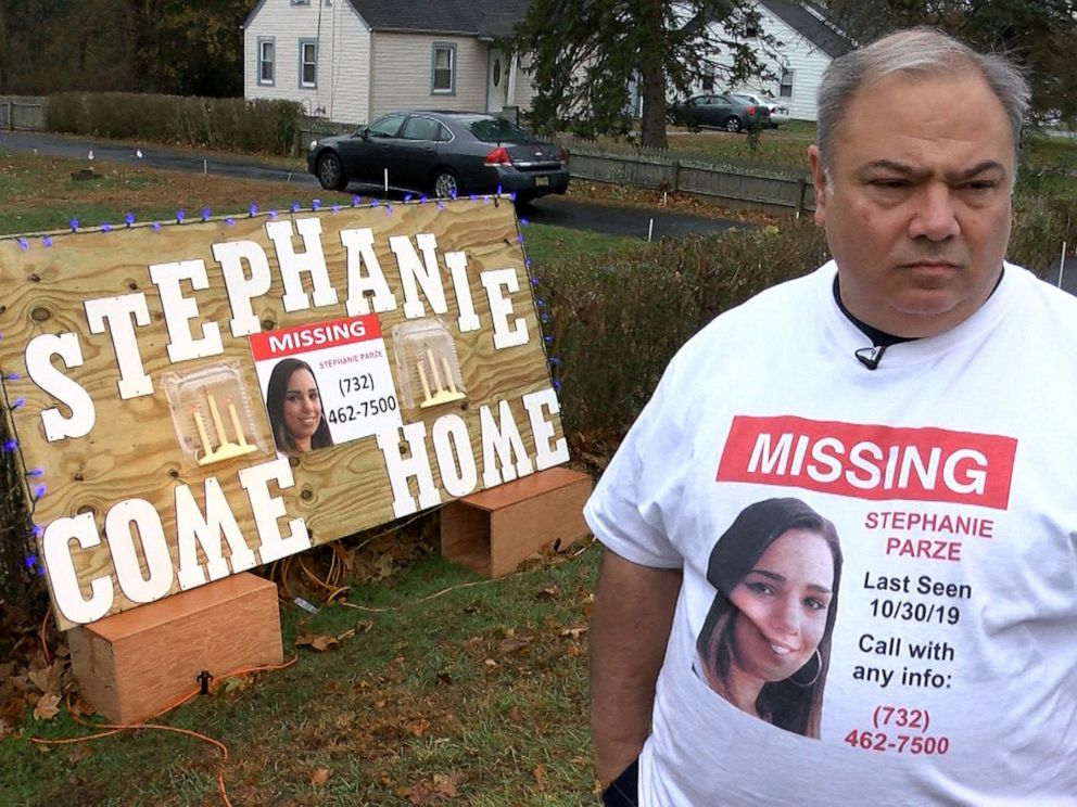 PHOTO: Edward Parze stands next to a large sign Monday, November 18, 2019, outside his Freehold home that asks his missing daughter Stephanie to come home. The woman has been missing since the night before Halloween.