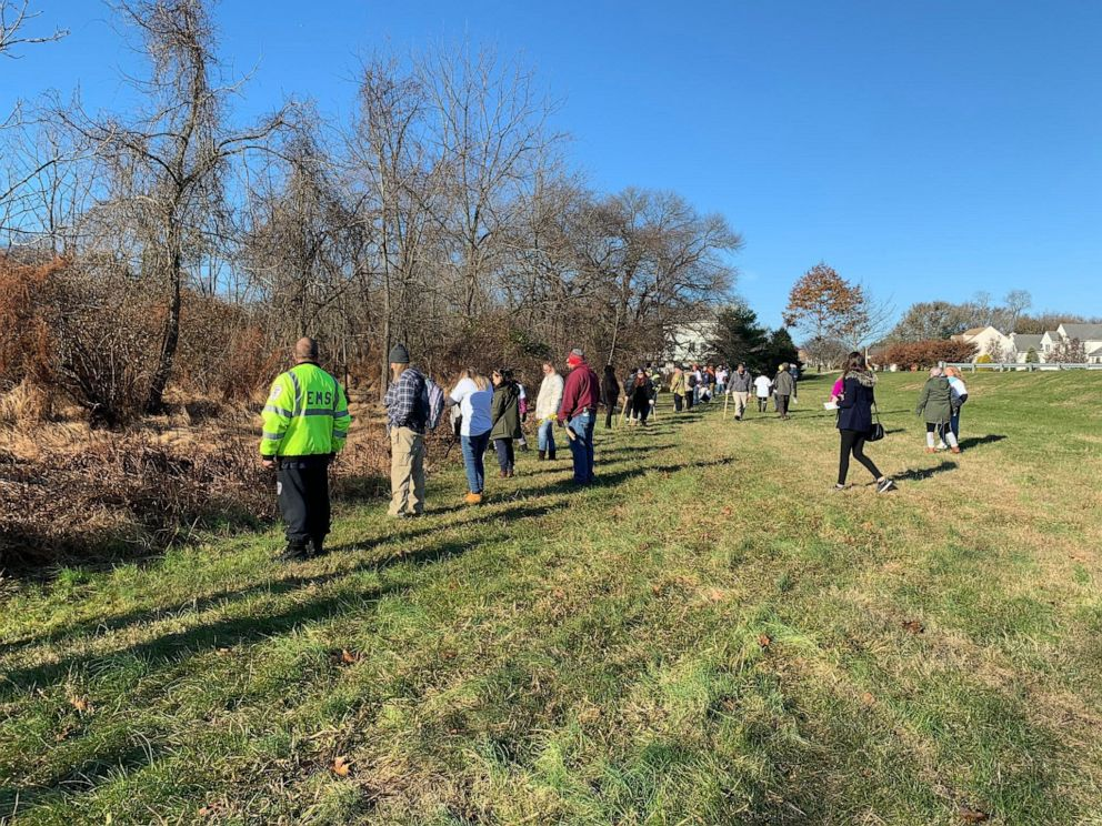 PHOTO: Volunteers gather Thursday, Nov. 21, 2019, to search for Stephanie Parze in a wooded area near her Freehold Township house.