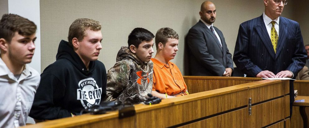 PHOTO: Trevor Gray, 15, Alexzander Miller, 15, Mikadyn Payne, 16, and Kyle Anger, 17, all of Clio, Mich., appear for their arraignment in front of Judge William Crawford on Tuesday, Oct. 24, 2017, in Genesee County District Court in downtown Flint, Mich.