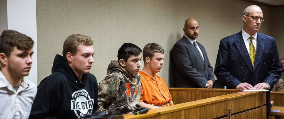 From left to right, Trevor Gray, 15, Alexzander Miller, 15, Mikadyn Payne, 16, and Kyle Anger, 17, all of Clio, Mich., appear for their arraignment on Tuesday, Oct. 24, 2017, in Genesee County District Court in Flint, Mich.