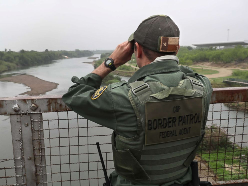 PHOTO: A U.S. Border Patrol agent scans the U.S.-Mexico border while on a bridge over the Rio Grande, March 13, 2017, in Roma, Texas