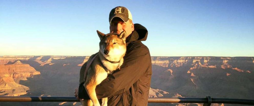 PHOTO: Paul Heroux, the mayor of Attleboro, Mass., holds his dog Mura at the Grand Canyon National Park in Canyon Village, Ariz.
