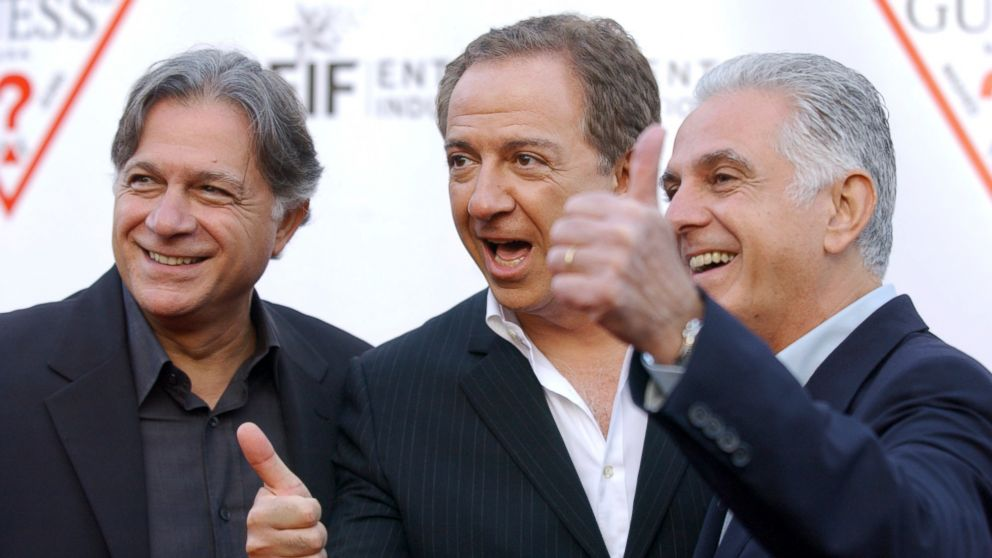 In this May 9, 2002 file photo, Guess Inc. founders and brothers, from left, Armand, Paul and Maurice Marciano arrive at the company's 20th anniversary party in Los Angeles.