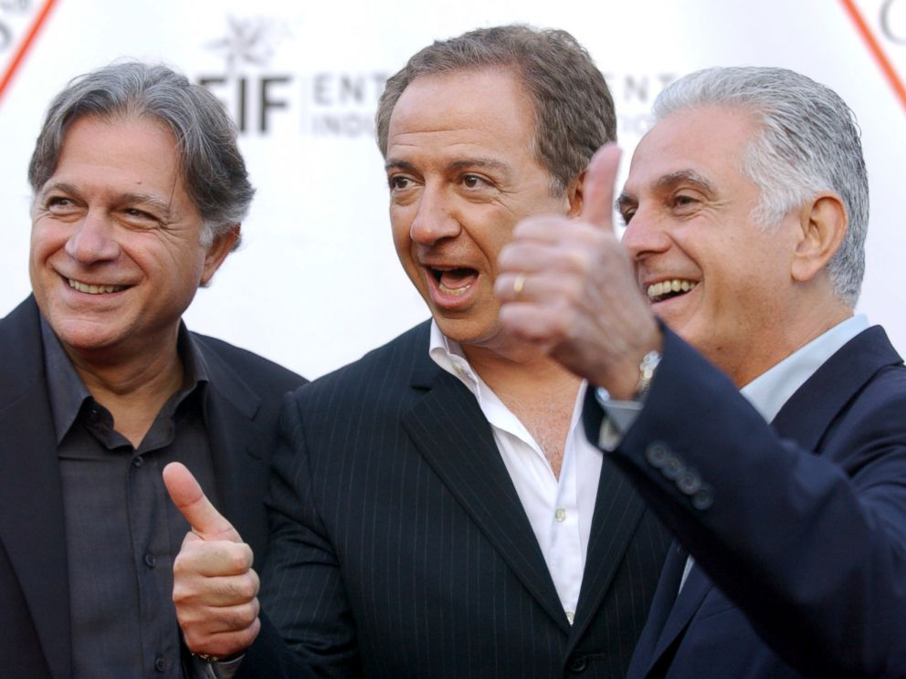 In this May 9, 2002 file photo, Guess Inc. founders and brothers, from left, Armand, Paul and Maurice Marciano arrive at the companys 20th anniversary party in Los Angeles.