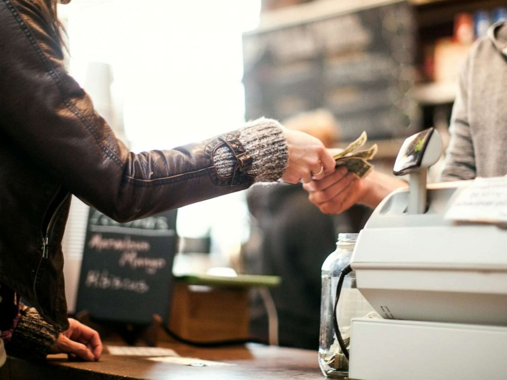 PHOTO: A woman pays for an item in this stock photo.