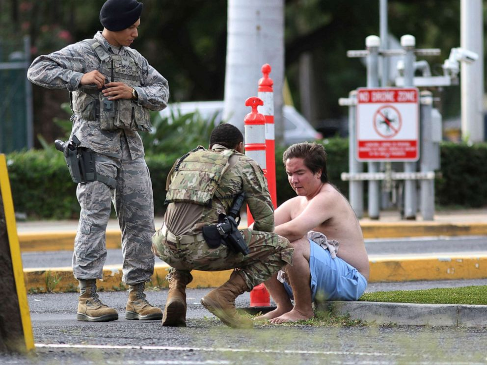 PHOTO: Security forces attend to an unidentified male outside the the main gate at Joint Base Pearl Harbor-Hickam, Dec. 4, 2019, in Hawaii, following a shooting.