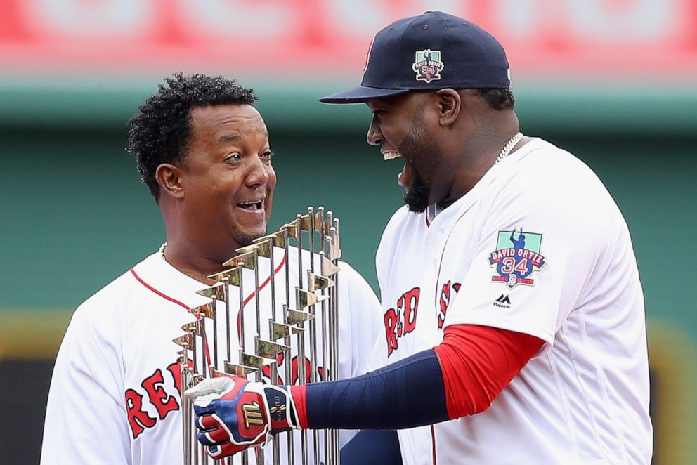 PHOTO: Boston Red Soxs Pedro Martinez and David Ortiz laugh during the pregame ceremony to honor Ortizs retirement before his last regular season home game at Fenway Park, Oct. 2, 2016 in Boston.