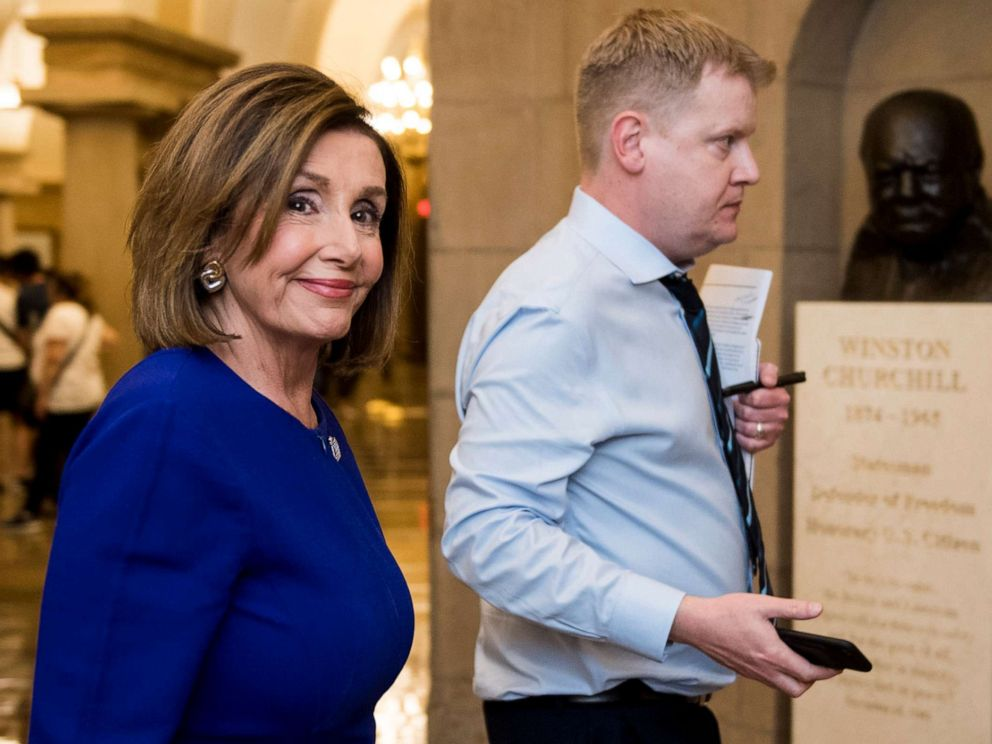 PHOTO: Speaker of the House Nancy Pelosi walks with her Deputy Chief of Staff Drew Hamill past the Sir Winston Churchill bust as she exits the Capitol on Sept. 24, 2019.