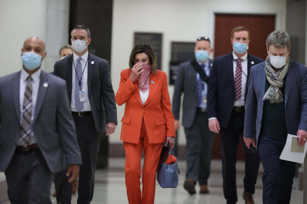 Speaker of the House Nancy Pelosi is surrounded by security and staff as she arrives for her weekly news conference during the novel coronavirus pandemic at the U.S. Capitol April 24, 2020 in Washington, D.C.Chip Somodevilla/Getty Images