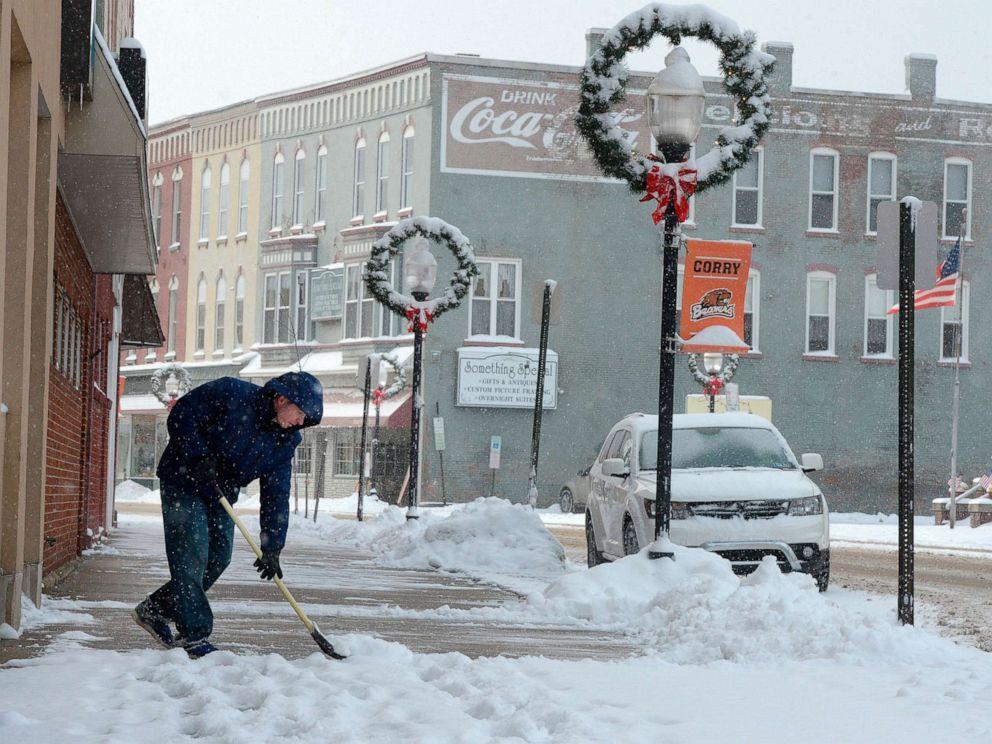 PHOTO: Ben Barney shovels the sidewalk on North Center Street in downtown Corry, Pennsylvania, Nov. 12, 2019.