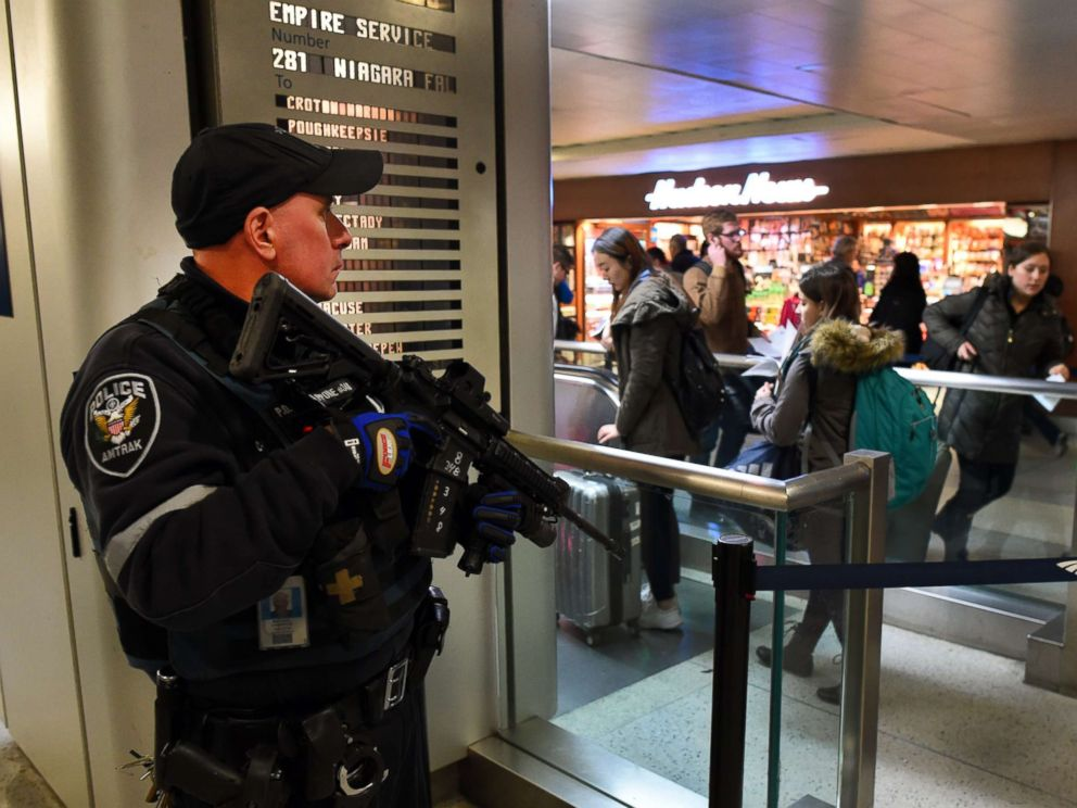PHOTO: An Amtrak Police officer watches passengersas they board a train at Penn Station on Nov. 24, 2015 in New York.