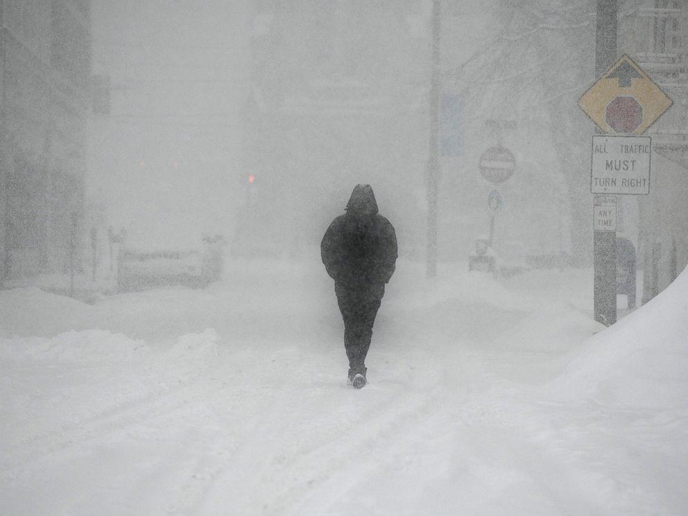 PHOTO: Khairi Musawir walks along Locust street in Johnstown, Pa., during a snow burst, Feb. 20, 2019.