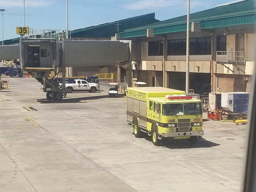 This Friday, Aug. 31, 2018 photo provided by Nicholas Andrade shows a fire truck outside a Hawaiian Airlines jet in Kahului, Hawaii, after a can of pepper spray went off inside the plane during a flight from Oakland, Calif.