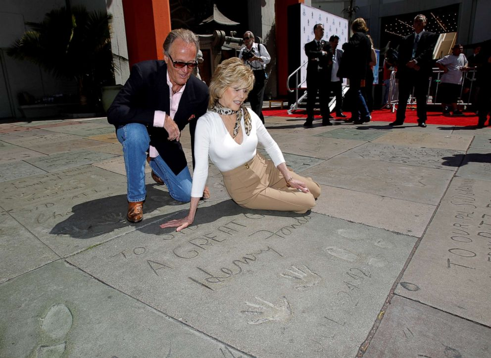 PHOTO: Jane Fonda and her brother, actor Peter Fonda, look at their fathers, actor Henry Fonda, handprints and footprints after her hand and footprint ceremony in the forecourt of the Chinese theatre in Hollywood, California, April 27, 2013.
