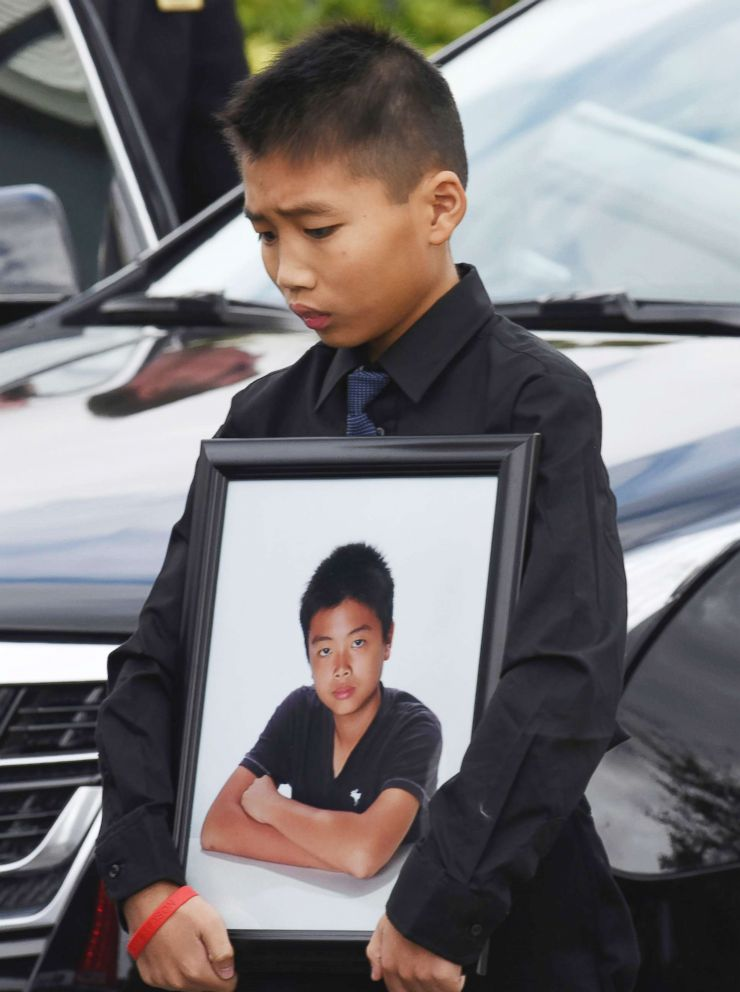 PHOTO: Alex Wang holds a picture of his brother, Peter Wang, a victim in the shooting at Marjory Stoneman Douglas High School, after his brothers funeral on Feb. 20, 2018, at Kraeer Funeral Home in Coral Springs, Fla.