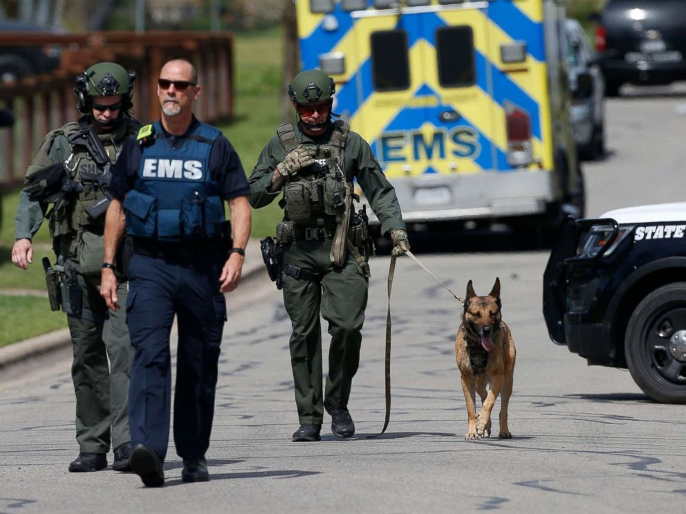 PHOTO: Police walk through a Pflugerville neighborhood as the FBI investigates the home of Austin bombing suspect Mark Anthony Conditt, March 21, 2018.