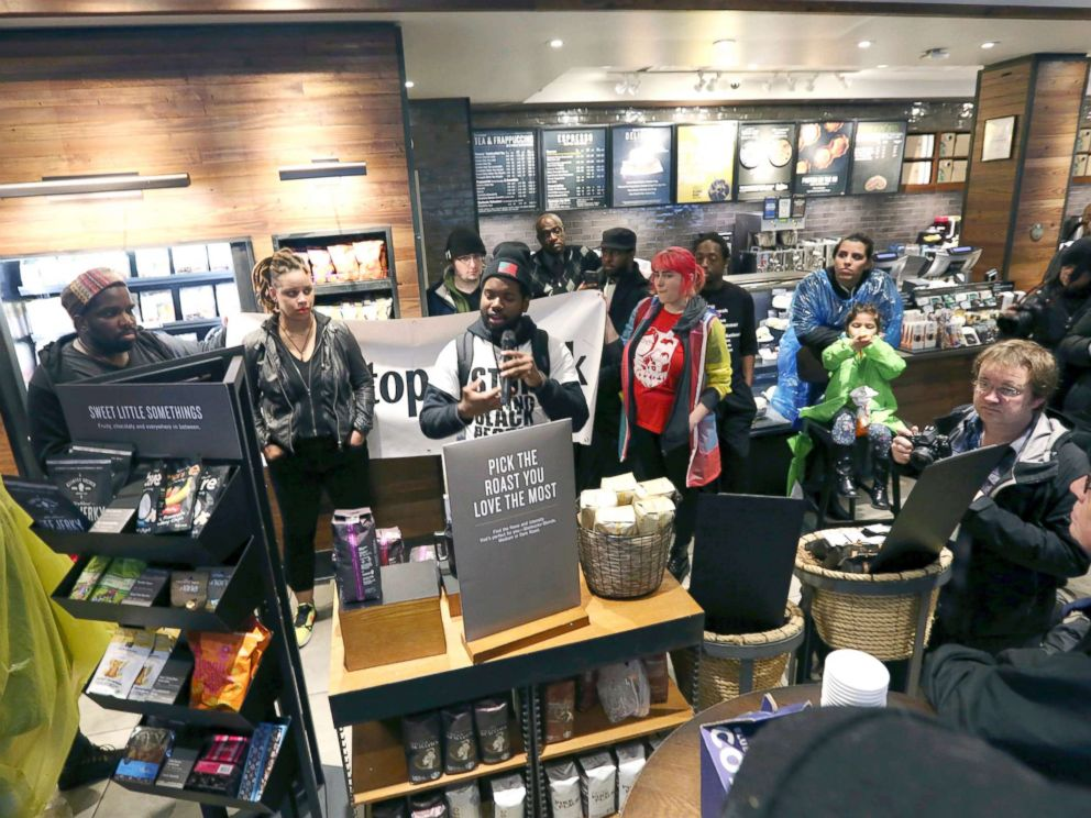 PHOTO: Demonstrators occupy the Starbucks that has become the center of protests Monday, April 16, 2018, in Philadelphia.