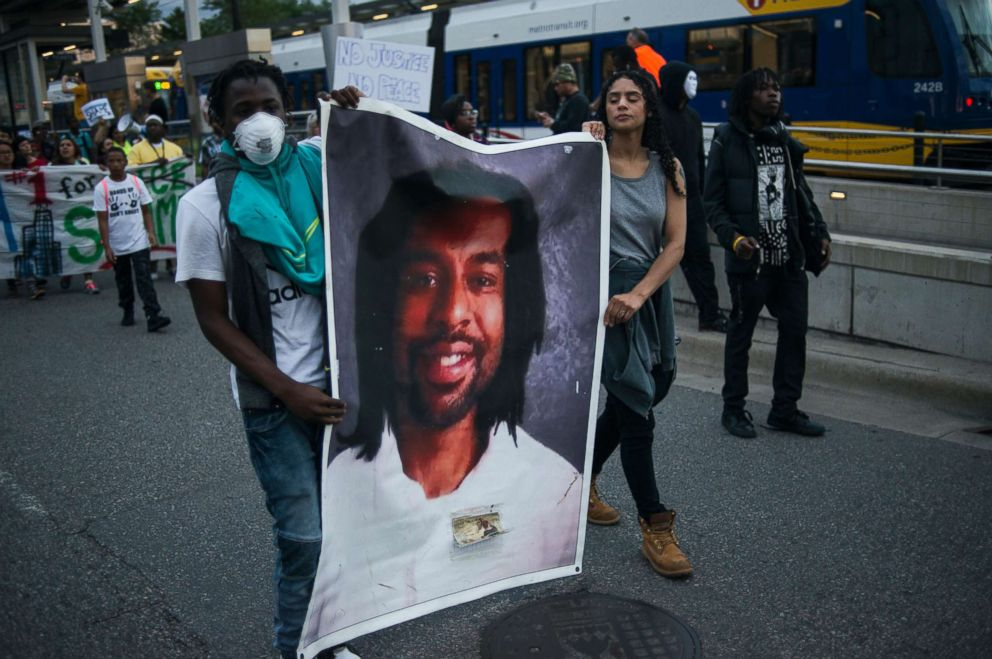 PHOTO: Protesters carry a portrait of Philando Castile on June 16, 2017 in St. Paul, Minn.