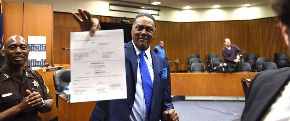 PHOTO: Richard Phillips shows his order of dismissal of homicide charges against him in Detroit, March 28, 2018. Phillips murder conviction was thrown out after he spent 45 years in prison.