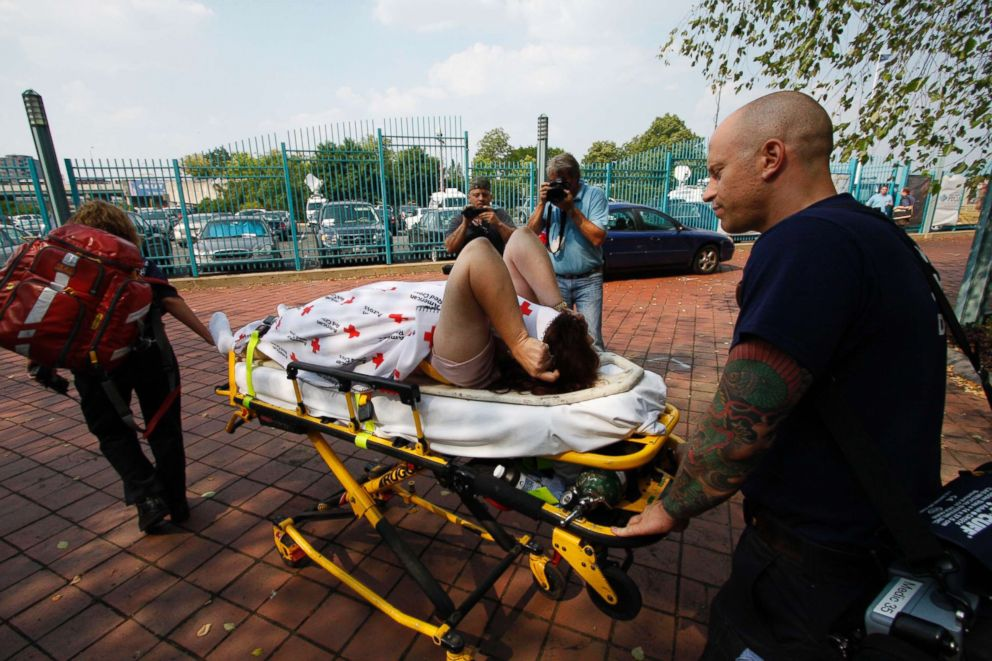 PHOTO: An unidentified person is escorted to an ambulance at the scene where a tourist boat carrying 37 people overturned on the Delaware River when a barge hit it in Philadelphia, July 7, 2010.