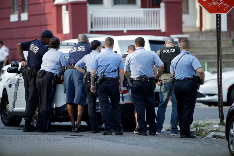 PHOTO: Philadelphia police stage as they respond to an active shooting situation, Aug. 14, 2019, in the Nicetown neighborhood of Philadelphia.