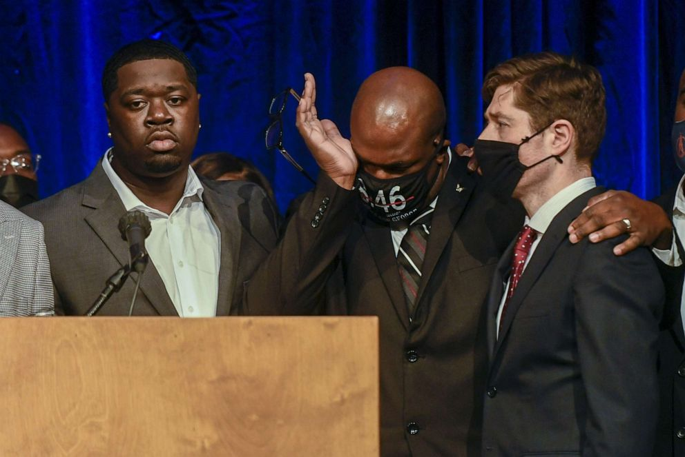 PHOTO: George Floyd's brother, Philonise Floyd, puts his arm around Minneapolis Mayor Jacob Frey as George Floyd's nephew Brandon Williams looks on during a press conference in Minneapolis, March 12, 2021.
