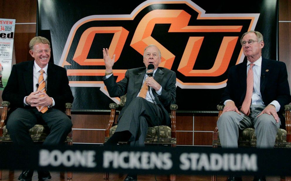 PHOTO: T. Boone Pickens, center, answers a question during a news conference Monday, Aug. 17, 2009, in Stillwater, Okla., after touring the new stadium renovations at Oklahoma State for which Pickens provided the bulk of the funding.