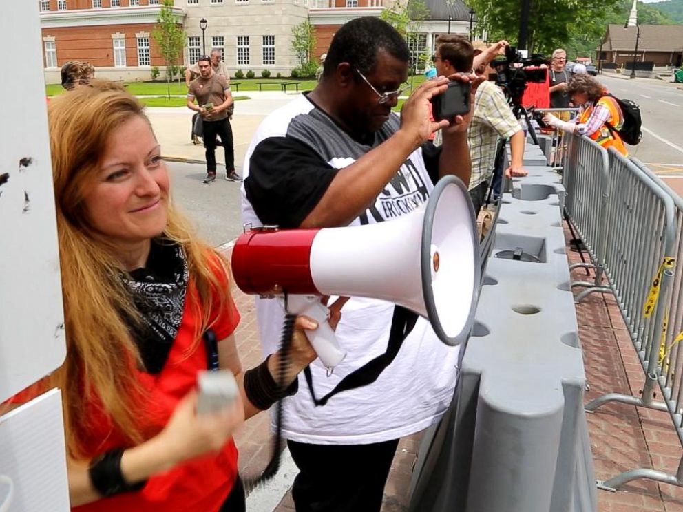 PHOTO: Daryle Lamont Jenkins, right in black and white, an antifa researcher and founder of One Peoples Project, and Lacy MacAuley, left, a prominent antifa movement organizer, are pictured on April 29, 2017.