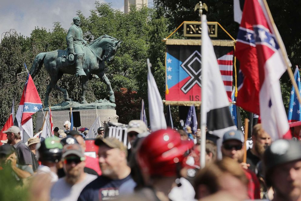 PHOTO: The statue of Confederate General Robert E. Lee stands behind a crowd during the Unite the Right rally Aug. 12, 2017 in Charlottesville, Va.