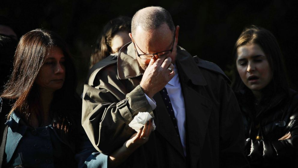 A mourner reacts outside Rodef Shalom Congregation before the funeral services for brothers Cecil and David Rosenthal, Oct. 30, 2018, in Pittsburgh.