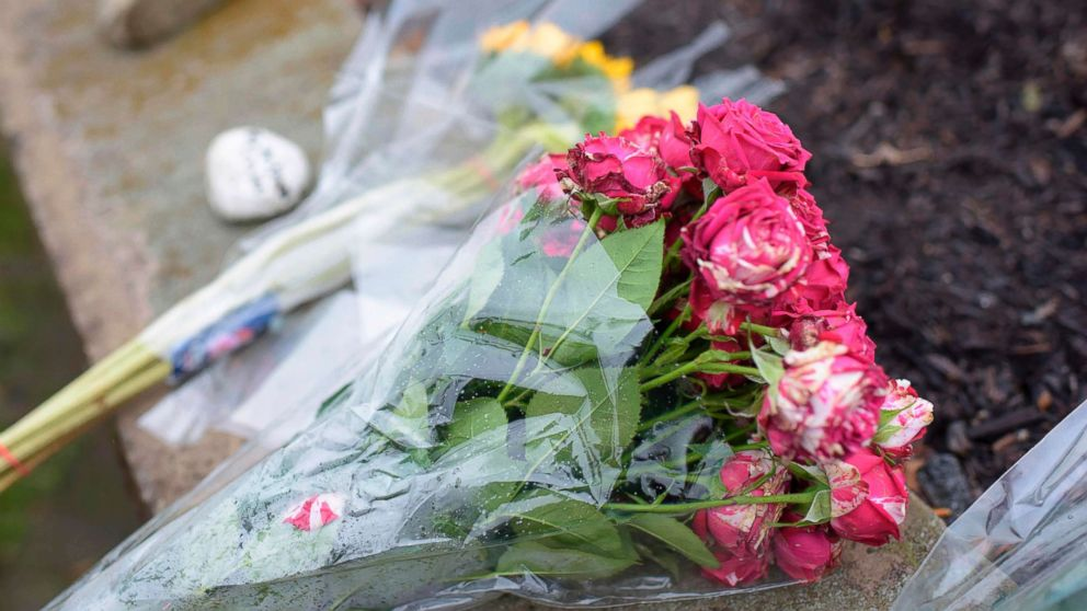 Flowers are left on a sidewalk after a shooting at the Tree of Life Synagogue in Pittsburgh, Oct. 27, 2018.