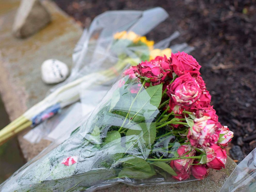 PHOTO: Flowers are left on a sidewalk after a shooting at the Tree of Life Synagogue in Pittsburgh, Oct. 27, 2018.