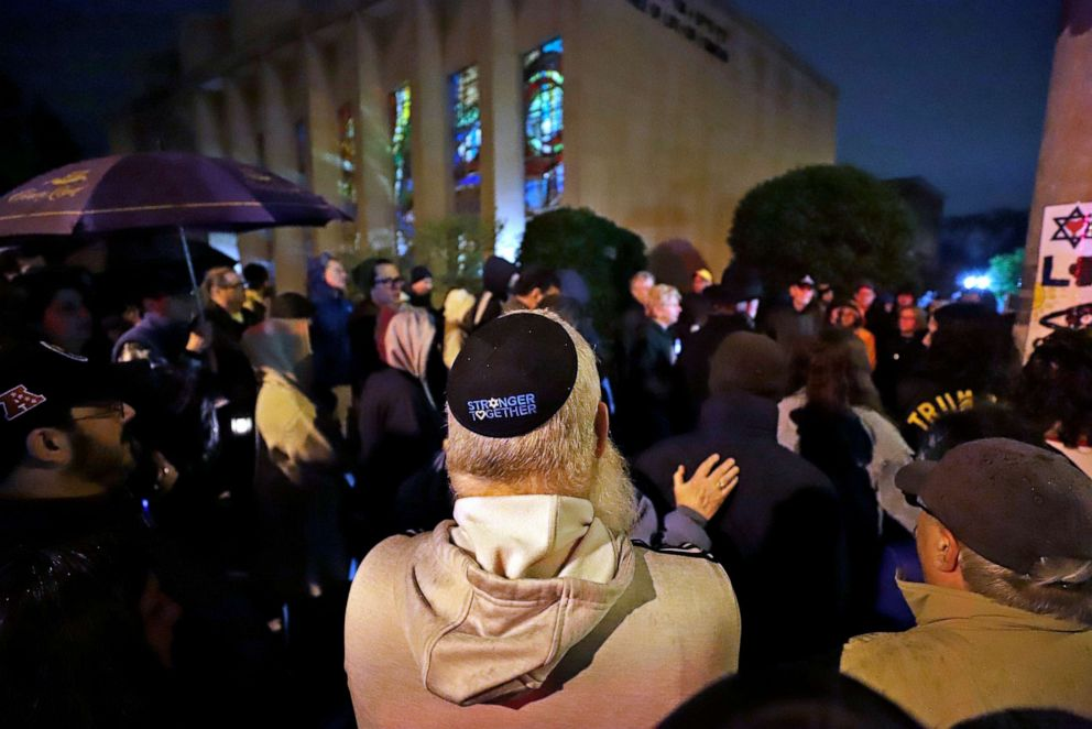 PHOTO: A group gathers outside the Tree of Life Synagogue for a vigil to honor the victims of the attack on a synagogue in California, April 27, 2019, in the Squirrel Hill neighborhood of Pittsburgh, where a gunman had killed 11 people six months earlier.