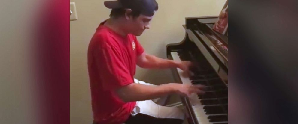 PHOTO: Bryce Dudal, 18, plays piano after delivering a pizza to a family in Sterling Heights, Mich.
