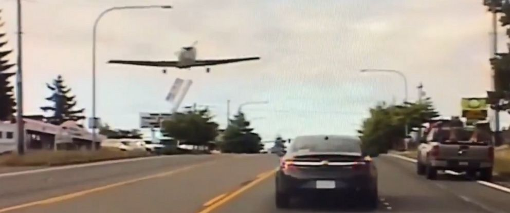 PHOTO: An image made from dash cam video released by Washington State Patrol shows a single engine plane making an emergency landing on a road in East Pierce County, Wash., Aug. 1, 2019.
