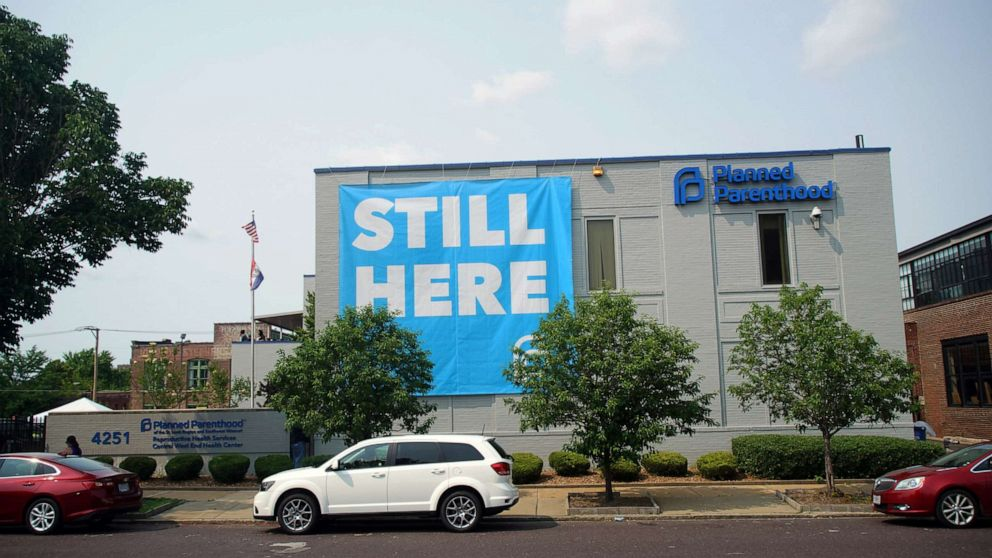 PHOTO: A banner stating STILL HERE hangs on the side of the Planned Parenthood Building after a judge granted a temporary restraining order on the closing of Missouris sole remaining Planned Parenthood clinic in St. Louis, May 31, 2019.